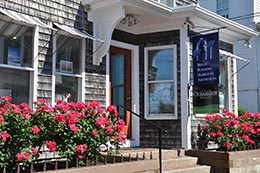 Cape Cod Oceanview Realty office in Provincetown with flowers outside